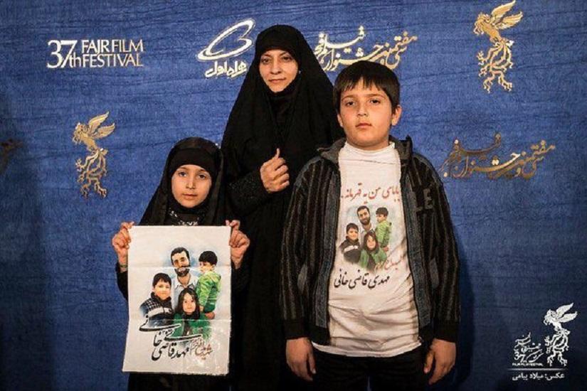 همسر شهید قاضی خانی و نهال در جشنواره فیلم فجر